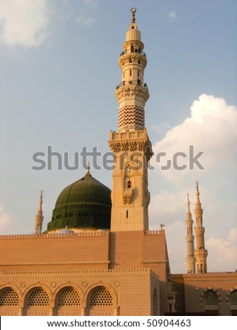 Nabawi mosque is Islam's second holiest mosque after Haram Mosque (in Mecca, Saudi Arabia). Beneath the green dome is where Prophet Muhammad (Peace be upon him) laid to rest. - stock photo