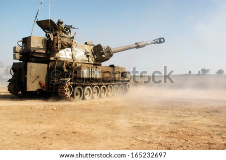 NACHAL OZ , ISR - JUNE 06:Israeli artillery M109 howitzer on June 06 2006.It's the most common Western indirect-fire support weapon of maneuver brigades of armored and mechanized infantry divisions. - stock photo