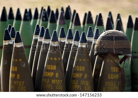 NACHAL OZ , ISR - MAY 30:Israeli artillery soldier helmet on live shells ready to be fired  on May 30 2005.The IDF artillery corp using advanced technology to improve its precision and effectiveness - stock photo