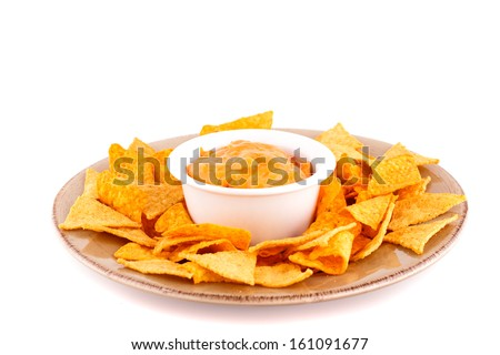 Nachos and cheese sauce isolated on white background. - stock photo