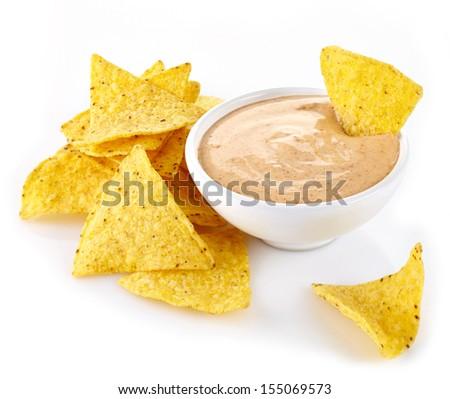 Nachos and dip on white background - stock photo