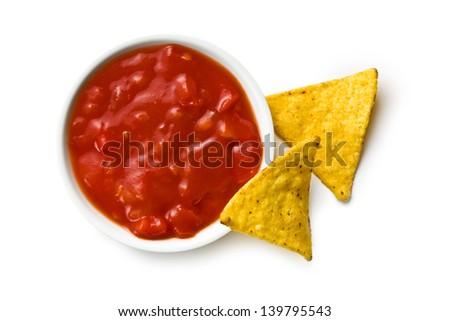 nachos and tomato dip on white background - stock photo