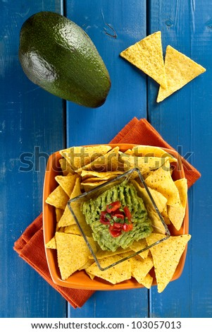 nachos with guacamole cream served on a bowl - stock photo