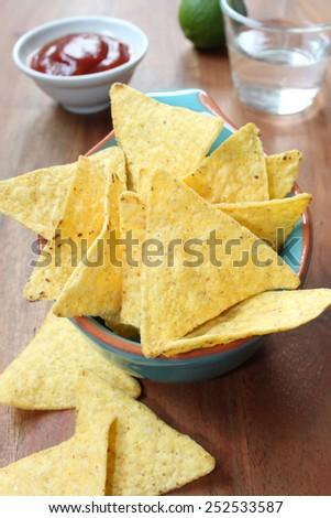 nachos with hot chili salsa - stock photo