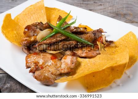 Nachos with meat  - stock photo
