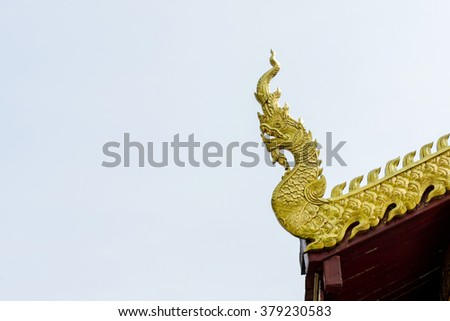 Naga or serpent on the roof ridge of Buddhist temple Thailand - stock photo