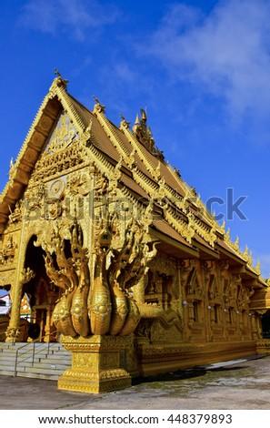 Naga statue, golden sanctuary in Nan, Northern of Thailand, blue sky, blue sky cloud - stock photo