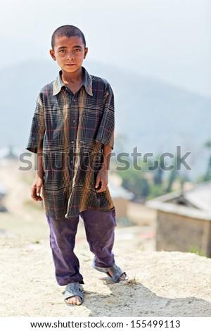 NAGARKOT, NEPAL - APRIL 5: Portrait of little unidentified Nepalese boy on April 5, 2009 in Nagarkot Village, Kathmandu, Central Region, Nepal. - stock photo