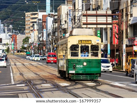 NAGASAKI, JAPAN - November 14 2013: Nagasaki served by 4 tram lines, operated by Nagasakic Electric Tramway, provide easy access to most city's main attractions and run every 5-8 minutes - stock photo