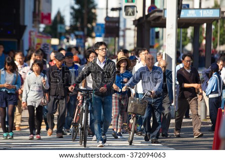 NAGOYA, JAPAN, DECEMBER 15, 2015 : A large number of people at pedestrian roads Japan - stock photo