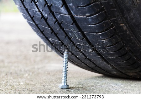 Nail and tire. The eternal nemesis - stock photo