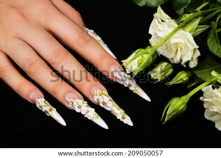 Nail art design on a black background. - stock photo