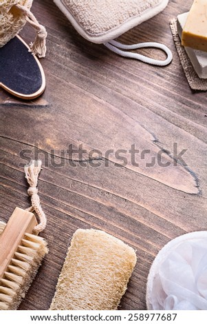 nail brush loofah wisp soap on vintage wooden board with copyspace  - stock photo