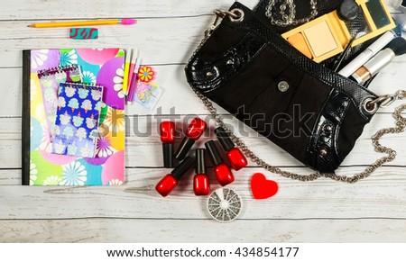 nail make-up Notebook Bag mirror cosmetics makeup bag woman lady stuff - stock photo