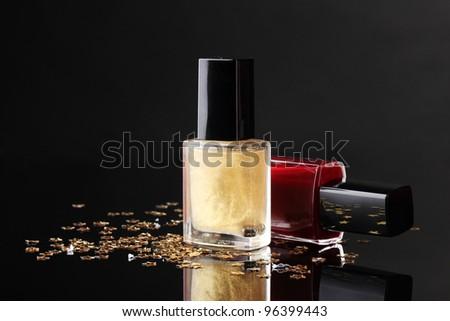 Nail polish bottles on black background - stock photo