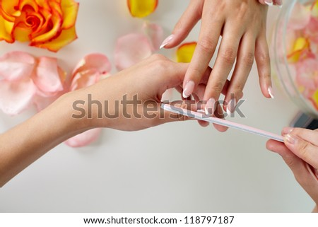 Nail treatment in a professional spa salon - stock photo