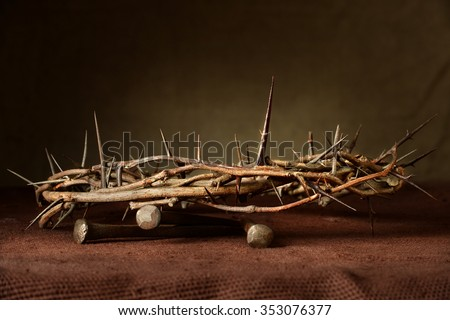 Nails and crown of thorns on cloth - stock photo