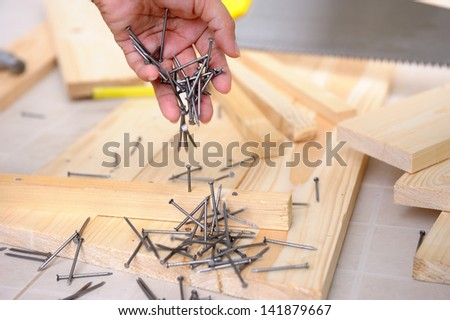 nails in carpenter's hand - stock photo