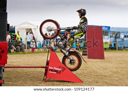 NAIRN, SCOTLAND - JULY 28: Ben Butterworth from the Inch Perfect Trials Display Team performs at the annual Nairnshire Farmers Show on JULY 28, 2012 in Nairn, Scotland - stock photo