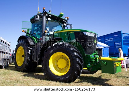 NAIRN, SCOTLAND - JULY 27: New John Deere 7280 tractor on display at the annual Nairn Farmers Show on July 27, 2013 in Nairn, Scotland - stock photo