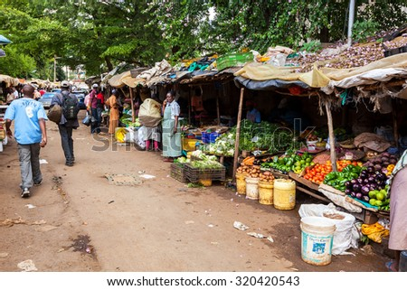 Nairobi, KENYA- December 31, 2012: Ripe fruit stacked at a local fruit and vegetable market on December 31, 2012 in Nairobi, Kenya. The market frequented by locals and tourists. - stock photo