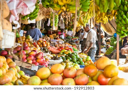 NAIROBI, KENYA- FEBRUARY 6, 2014: Ripe fruits stacked at a local fruit and vegetable market on February 6, 2014. Nairobi, Kenya. The market is frequently visited by locals and tourists. - stock photo