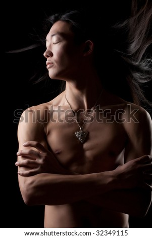 naked asian man with wind in the hair - stock photo