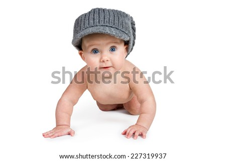 Naked baby in adult winter hat crawling towards the camera isolated on a white background - stock photo