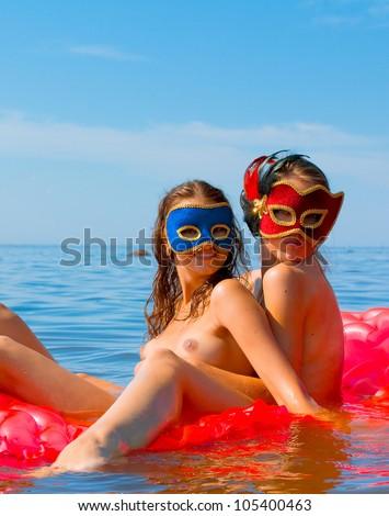 Naked Beach Masqueraders - stock photo