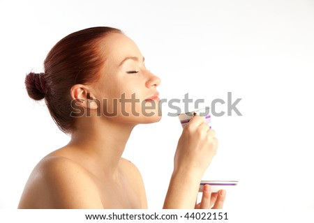 naked beautiful young woman with coffee cup on over white - stock photo