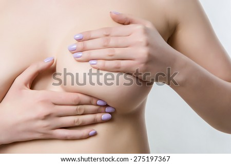 naked female breasts covered with his hands, checking for breast disease, medicine Concept, thrush, cancer - stock photo