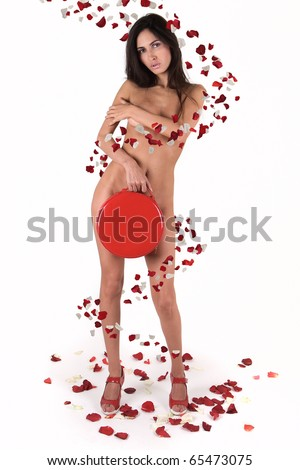 naked girl in rose petals on white background - stock photo