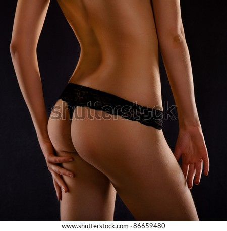 naked girl on a black background (silhouette) - stock photo