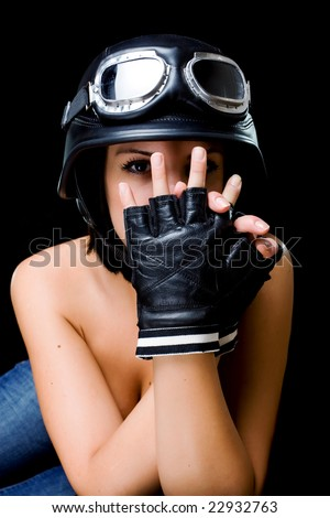 naked girl with US Army-style motorcycle helmet with goggles and gloves - stock photo