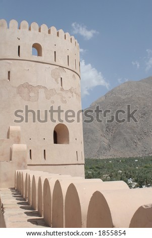 Nakhal Fort with Hajar Mountain Backdrop - stock photo