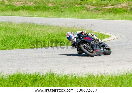 NAKHON PATHOM - JULY 25 : Pran J. with Yamaha motorcycle in Thailand SuperBikes Championship 2015 Round 1 at Thailand Circuit, on July 25, 2015 in Nakhon Pathom, Thailand. - stock photo