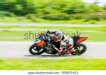 NAKHON PATHOM - JULY 25 : Pubad R. with Yamaha R3 motorcycle in Thailand SuperBikes Championship 2015 Round 1 at Thailand Circuit, on July 25, 2015 in Nakhon Pathom, Thailand. - stock photo