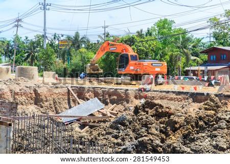 NAKHON PATHOM-THAILAND-MAY 16 : A loader for construction the road on May 16, 2015 Bangkok, Thailand. - stock photo
