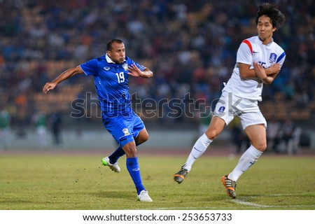 NAKHON RATCHASIMA THA-Feb07:Adul Lahso#19 of Thailand in action during the 43rd King's cup match between Thailand and Korea Rep at Nakhon Ratchasima stadium on February07,2015 in Thailand. - stock photo