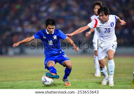 NAKHON RATCHASIMA THA-Feb07:Chanathip Songkrasin#18 of Thai contols a ball during the 43rd King's cup match between Thailand and Korea Rep at Nakhon Ratchasima stadium on February07,2015 in Thailand. - stock photo