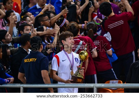 NAKHON RATCHASIMA THA-Feb07:Kim Min-hyeok of Korea holds the trophy during the 43rd King's cup match between Thailand and Korea Rep at Nakhon Ratchasima stadium on February07,2015 in Thailand - stock photo