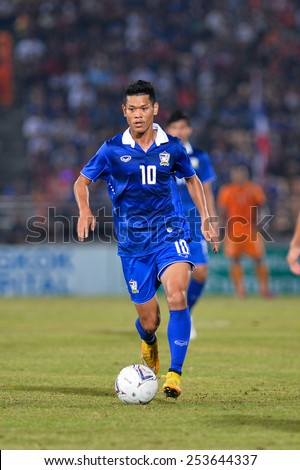 NAKHON RATCHASIMA THA-Feb07:Pokkhao Anan#10 of Thailand run with the ball during the 43rd King's cup match between Thailand and Korea Rep at Nakhon Ratchasima stadium on February07,2015 in Thailand - stock photo