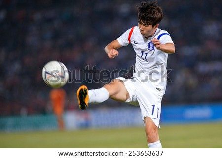 NAKHON RATCHASIMA THA-Feb07:Yun Il-lok of Korea Rep kicks the ball during the 43rd King's cup match between Thailand and Korea Rep at Nakhon Ratchasima stadium on February07,2015 in Thailand. - stock photo