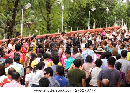 NAKHON RATCHASIMA , THAILAND - APRIL 12: Celebration of a new buddhist monk, new monks is thrown the money toward the many people for charity on April 12, 2015 in Nakhon Ratchasima , Thailand - stock photo