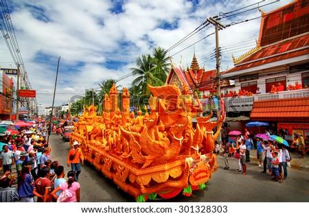 NAKHON RATCHASIMA, THAILAND - JULY 11 : Thai candle festival of buddha (The Buddhist Lent Day) on July 11, 2009 in Nakhon Ratchasima Province, thailand. - stock photo