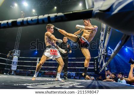 Nakhon Sawan, THAILAND- August 16 : Unidentified boxers compete in Thai Fight:Muay Thai World's Unrivaled Fight on August 16, 2014 , in Nakhon Sawan , Thailand - stock photo