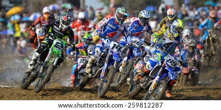 Nakhonchaisri,THAI-MAR 08:Motocross riders perform on the competes during the Thai MXGP World Championship at thailand Circuit on March08,2015 in Nakhonpathom,Thailand. - stock photo