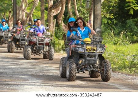 NAKHONNAYOK, THAILAND - DECEMBER 19 : Tourists riding ATV to nature adventure on DECEMBER 19, 2015, Thailand. - stock photo