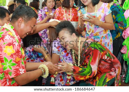 NAKHONRATCHASIMA, THAILAND - APRIL 11: Thai people celebrate Songkran the new year water festival  by giving garlands to their seniors and asked for blessings on April 11, 2014 in Nakhonratchasima, Thailand.  - stock photo