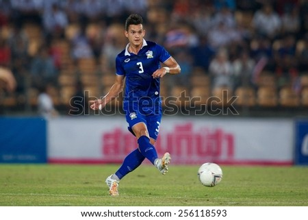 NAKHONRATCHASIMA THAILAND-FEB 04:Mika Chunuonsee of Thailand in action during the 43rd King's cup between Thailand and Uzbekistan at Nakhon ratchasima stadium on Feb 04,2015 in Thailand. - stock photo